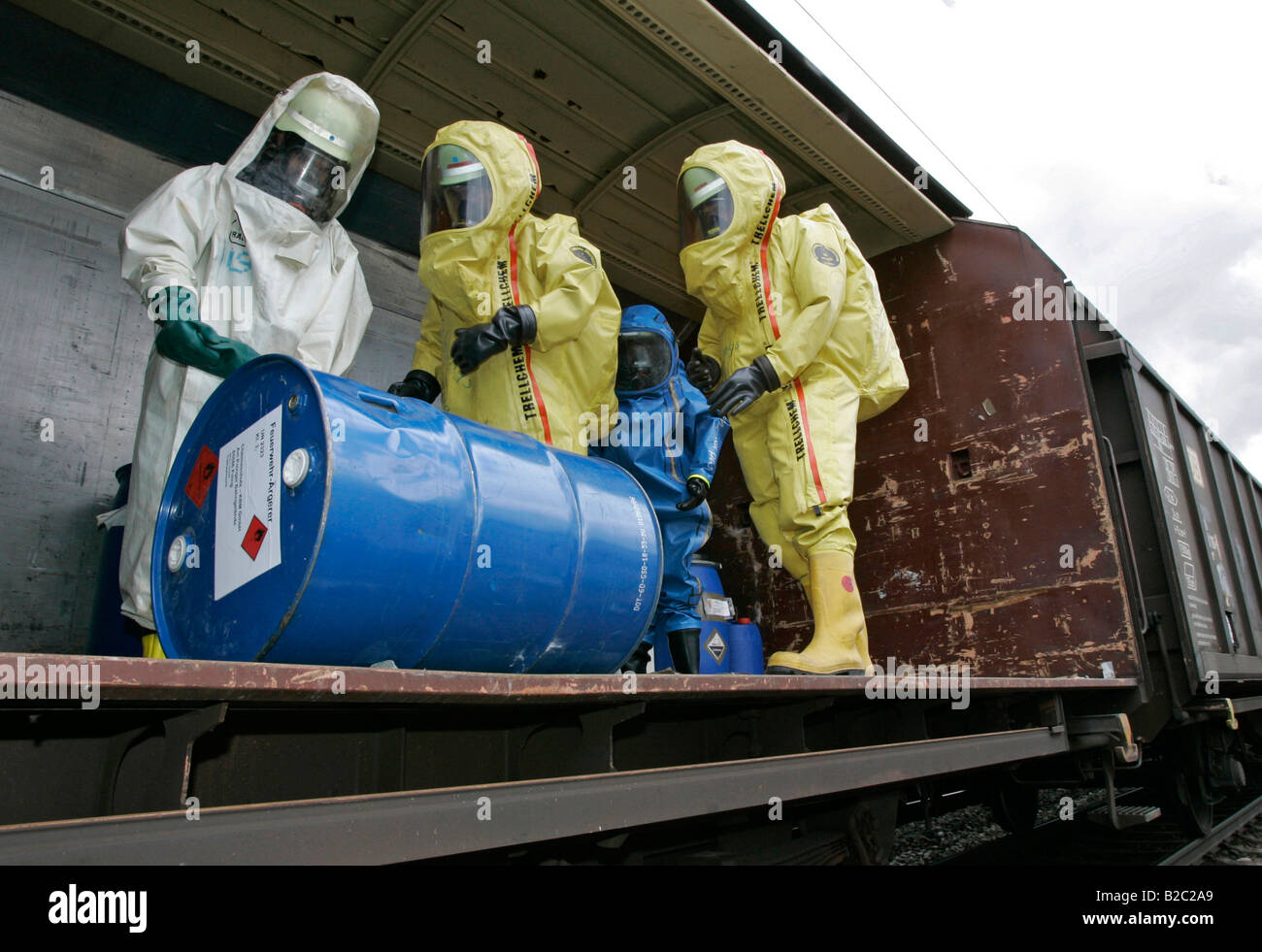Firemen wearing hazmat suits at work during a disaster control drill, near Poing, Bavaria, Germany, Europe - Stock Image