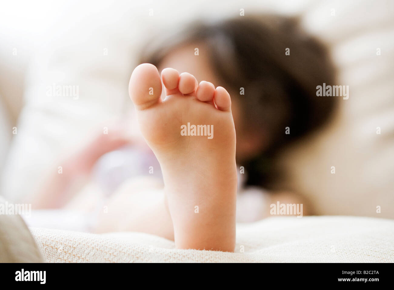Close up of a girl child's left foot - Stock Image
