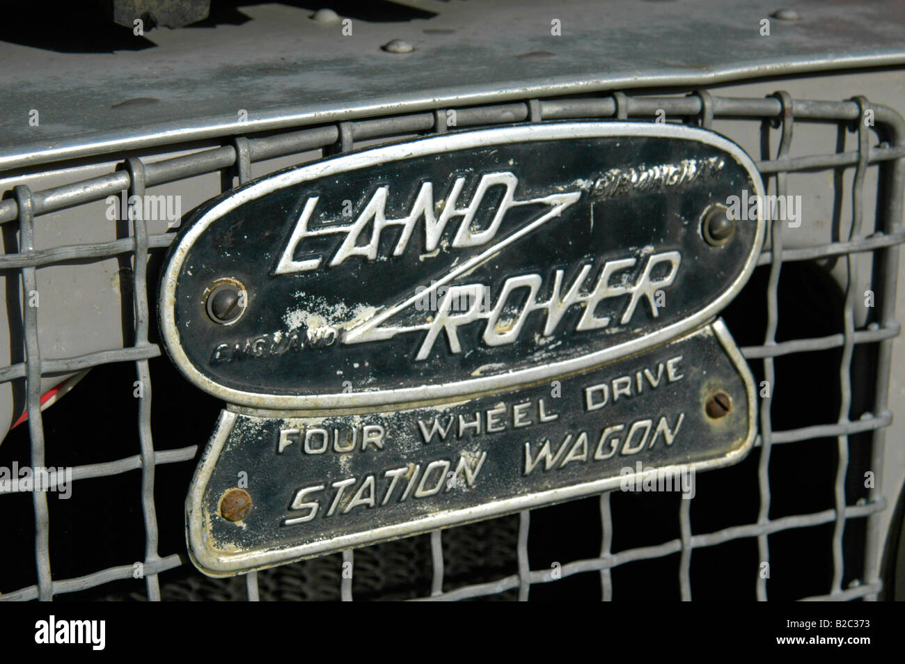 Land Rover enblem on grey 1950's Land Rover Series One 86 inch Station Wagon. - Stock Image