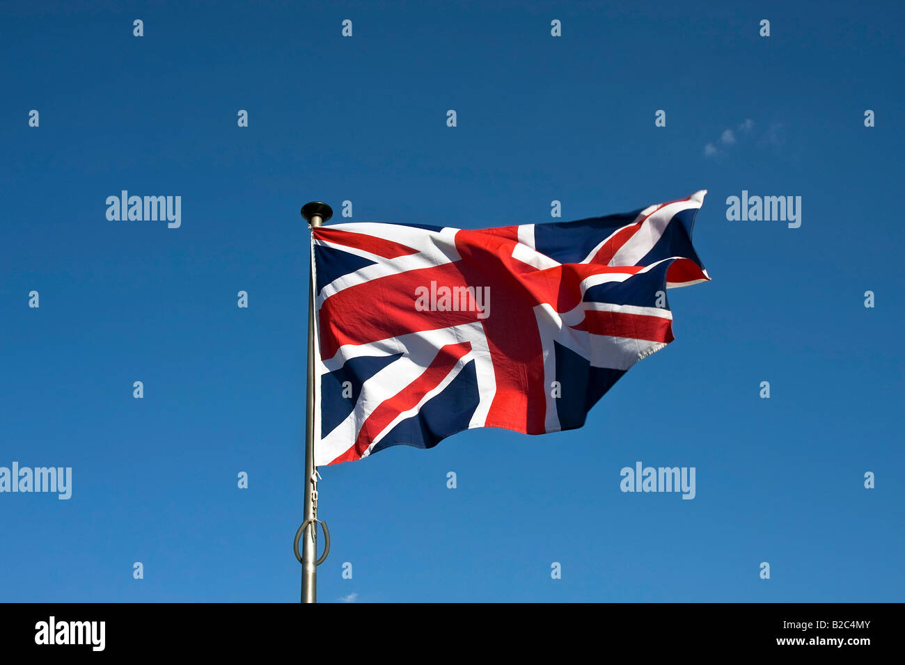 Union Jack, English Flag, Flag of Great Britain, fluttering in the wind on a flagpole Stock Photo