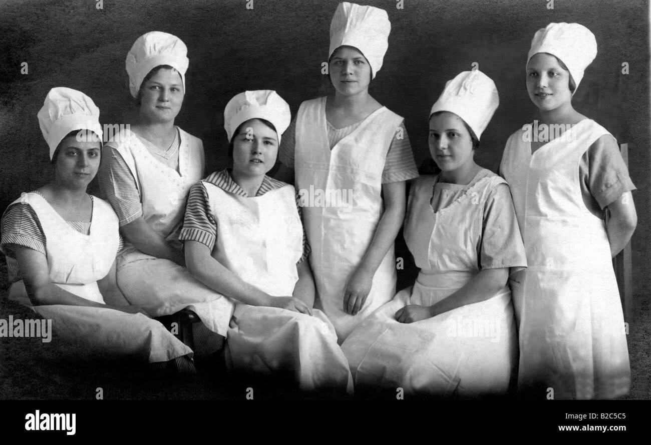 Six female bakers, historic picture from about 1920 Stock Photo