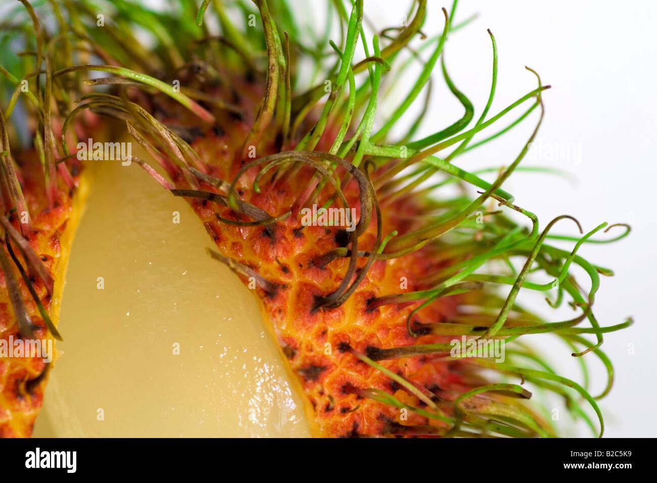 Rambutan (Nephelium lappaceum), macro image of tropical fruit - Stock Image
