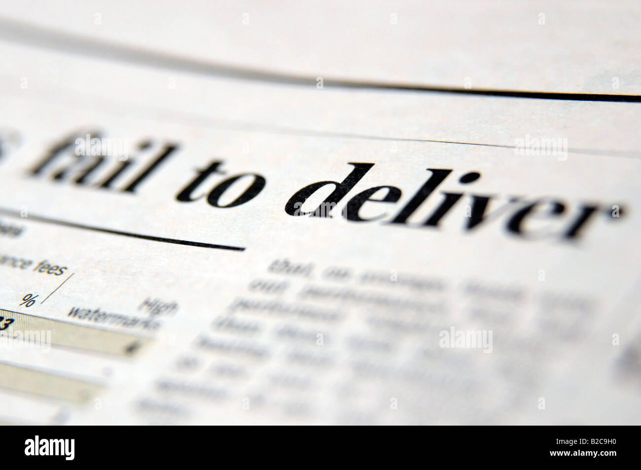 Photograph of newspaper headline about the credit crunch and economic downturn and recession failing to deliver - Stock Image