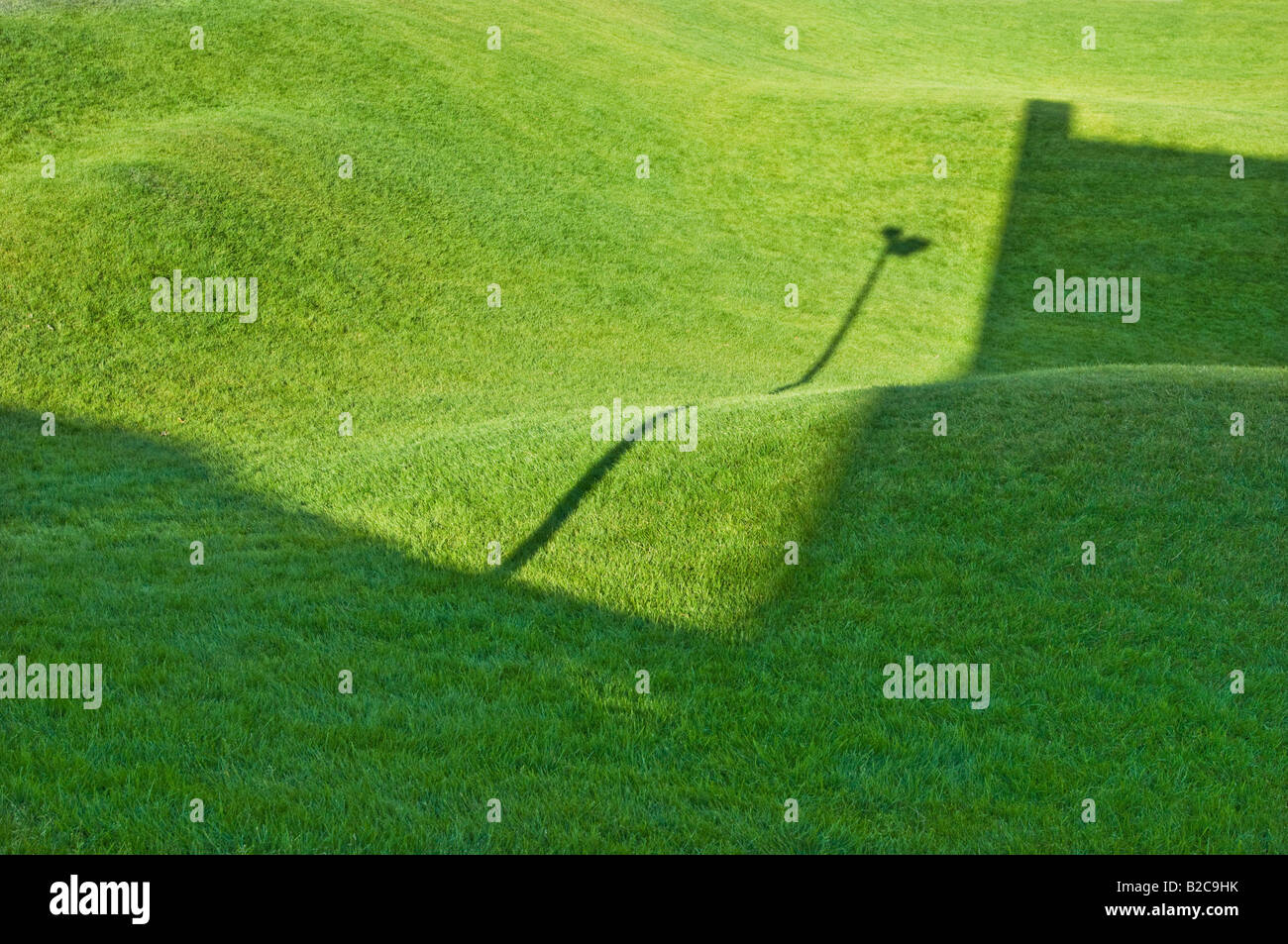green grass rise hill mound hillock knoll hump fresh galanty show shadow play ART artificial garden fee playground - Stock Image