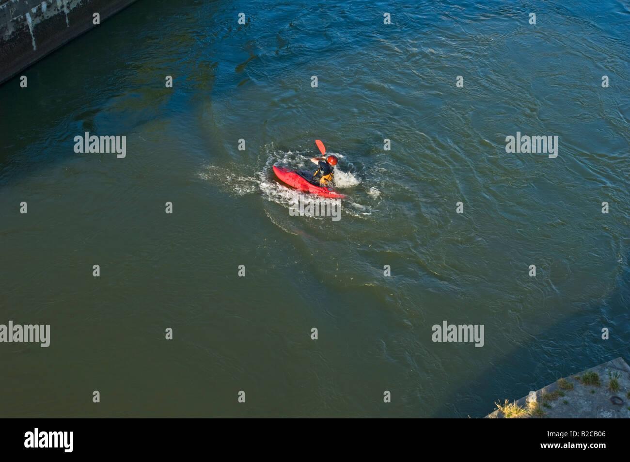 Canoeist Paddler on the river danube sports canoe paddle man river