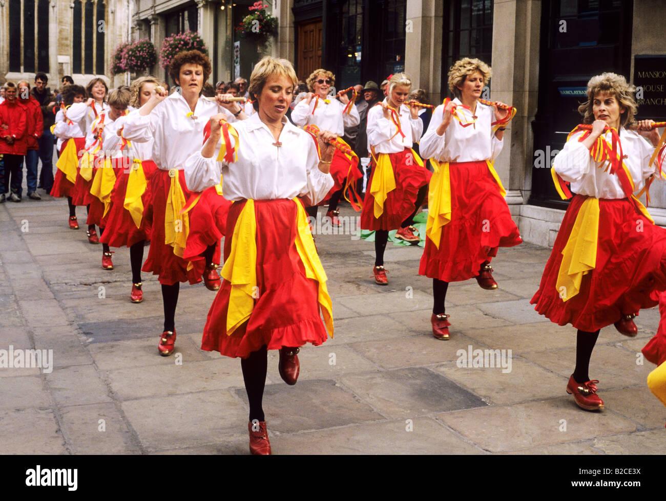 Women Ladies clog dancing dance red skirts York street dance entertainment performers Yorkshire England English - Stock Image