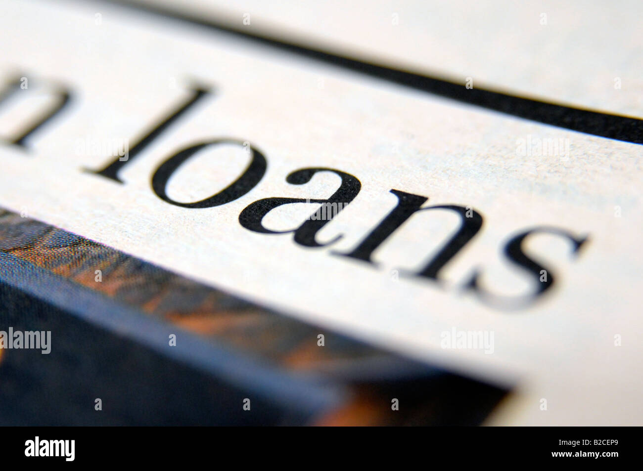 Photograph of newspaper headline about the credit crunch and economic downturn and recession leading to bank loans - Stock Image