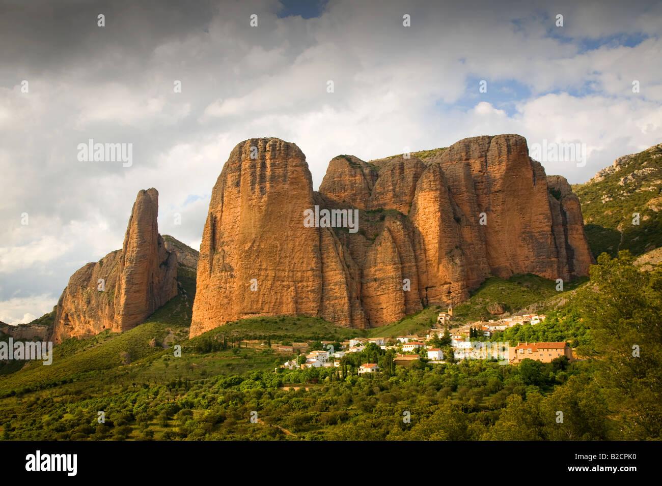 Hillside village of Riglos in Aragon near Pyrenees in Spain - Stock Image