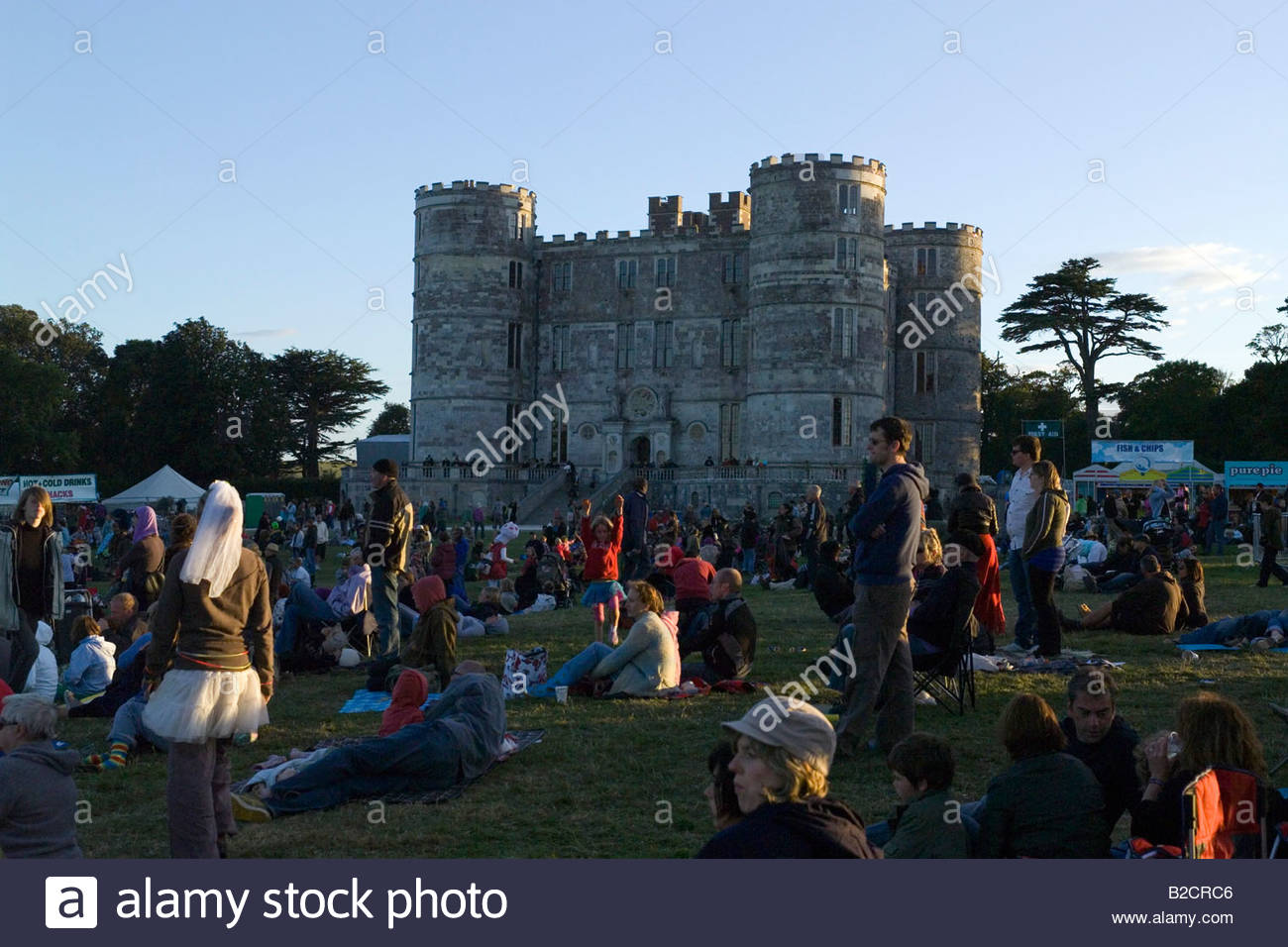 Concert audience and castle at Camp Bestival, Lulworth Castle, Dorset Summer 2008 - Stock Image