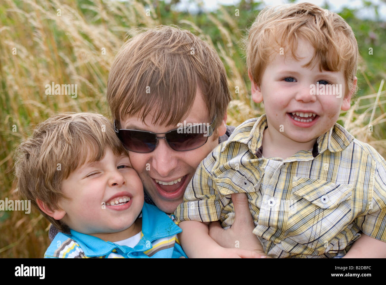 Father and two sons having fun. - Stock Image