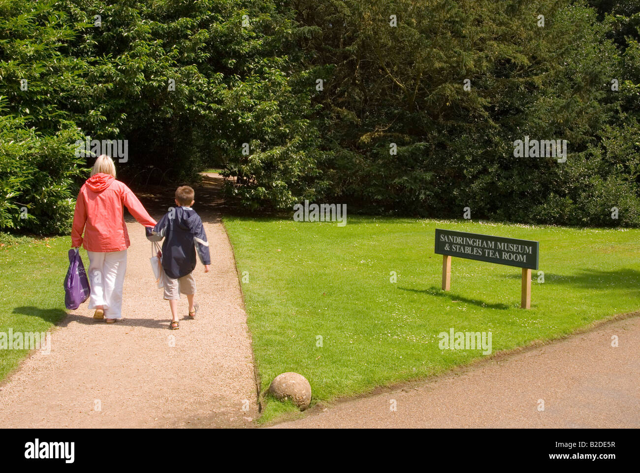 Mother And Son On Path Leading To Sandringham Museum And Stables Tea Room - Stock Image