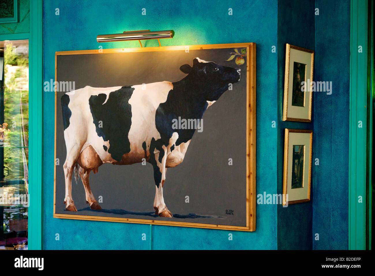 Hotel Saint Christophe in La Baule, the Dining room decor with large painting of a cow - Stock Image