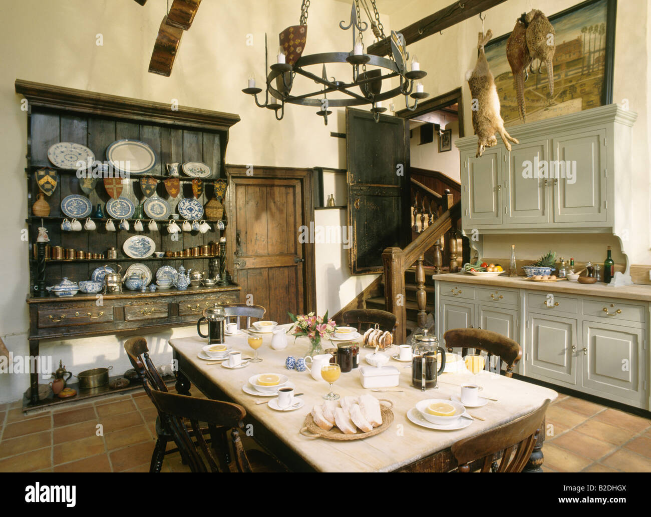 Table Set For Breakfast In Large Old Fashioned Kitchen Stock Photo 18738858 Alamy