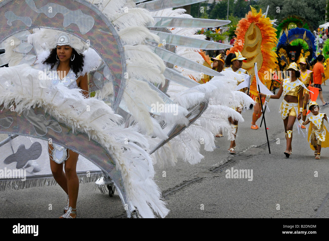 Beautiful black girl playing white Queen in float costume