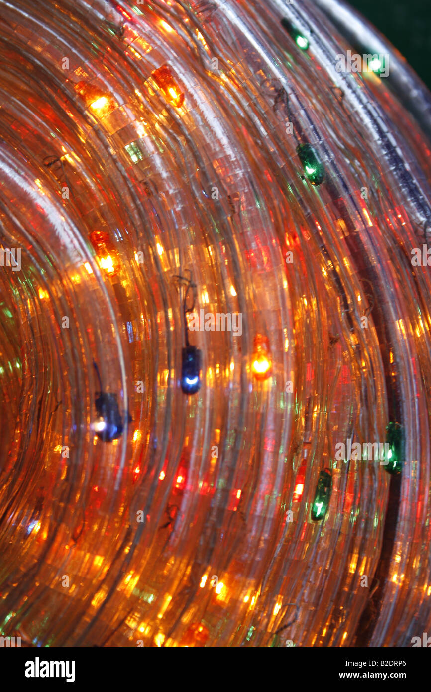 coil of bright tube christmas lights at night