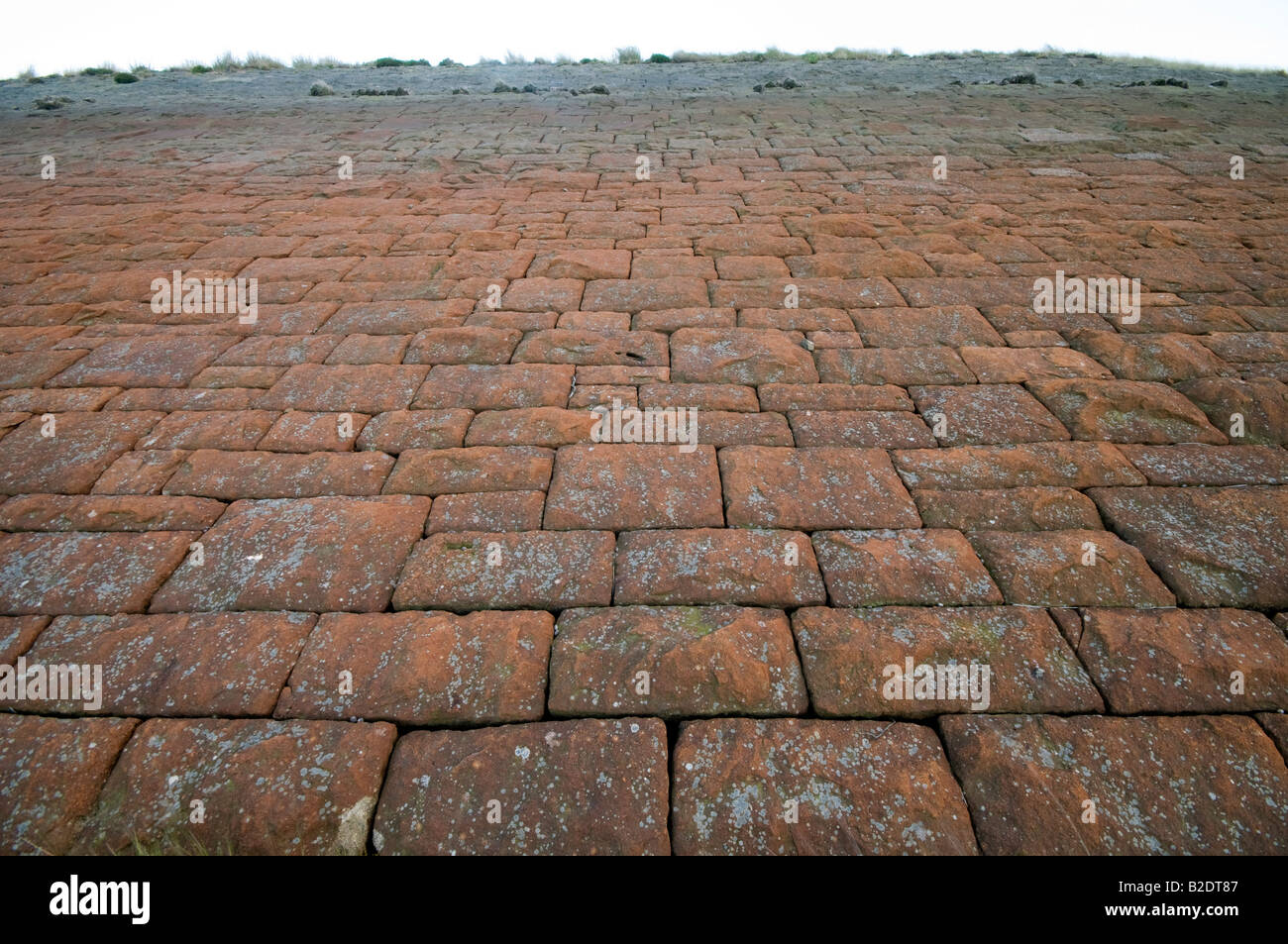 Stone blocks forming the main dam wall on drained reservoir - Stock Image