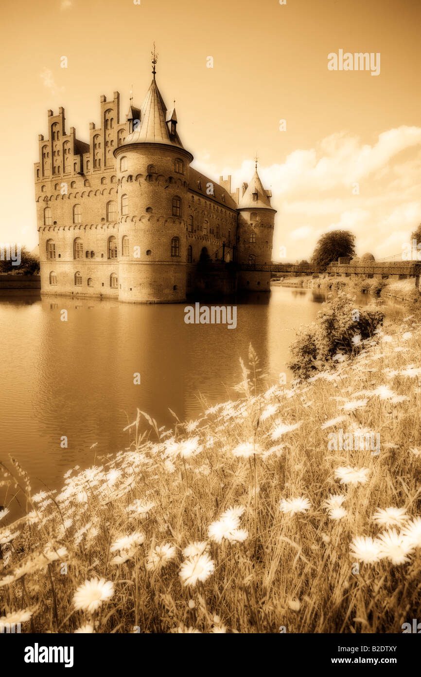 Daisy Edged Moat monochrome orton:The castle with its romantic round tower sits in its moat surrounded by grass - Stock Image