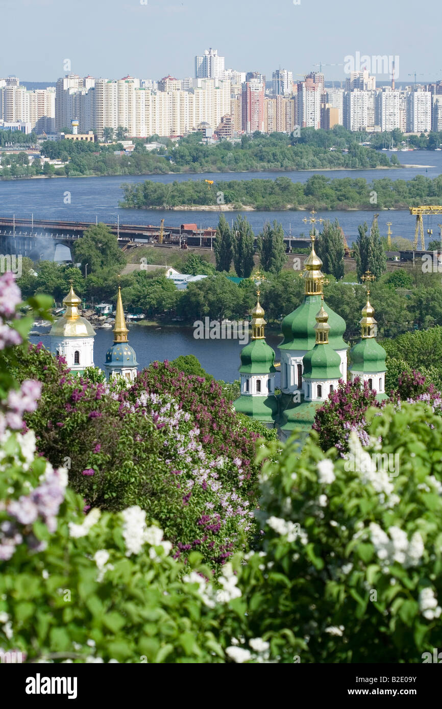 Blooming modern and ancient Kiev Ukraine Vidubichy manastery over the Dnipro river - Stock Image