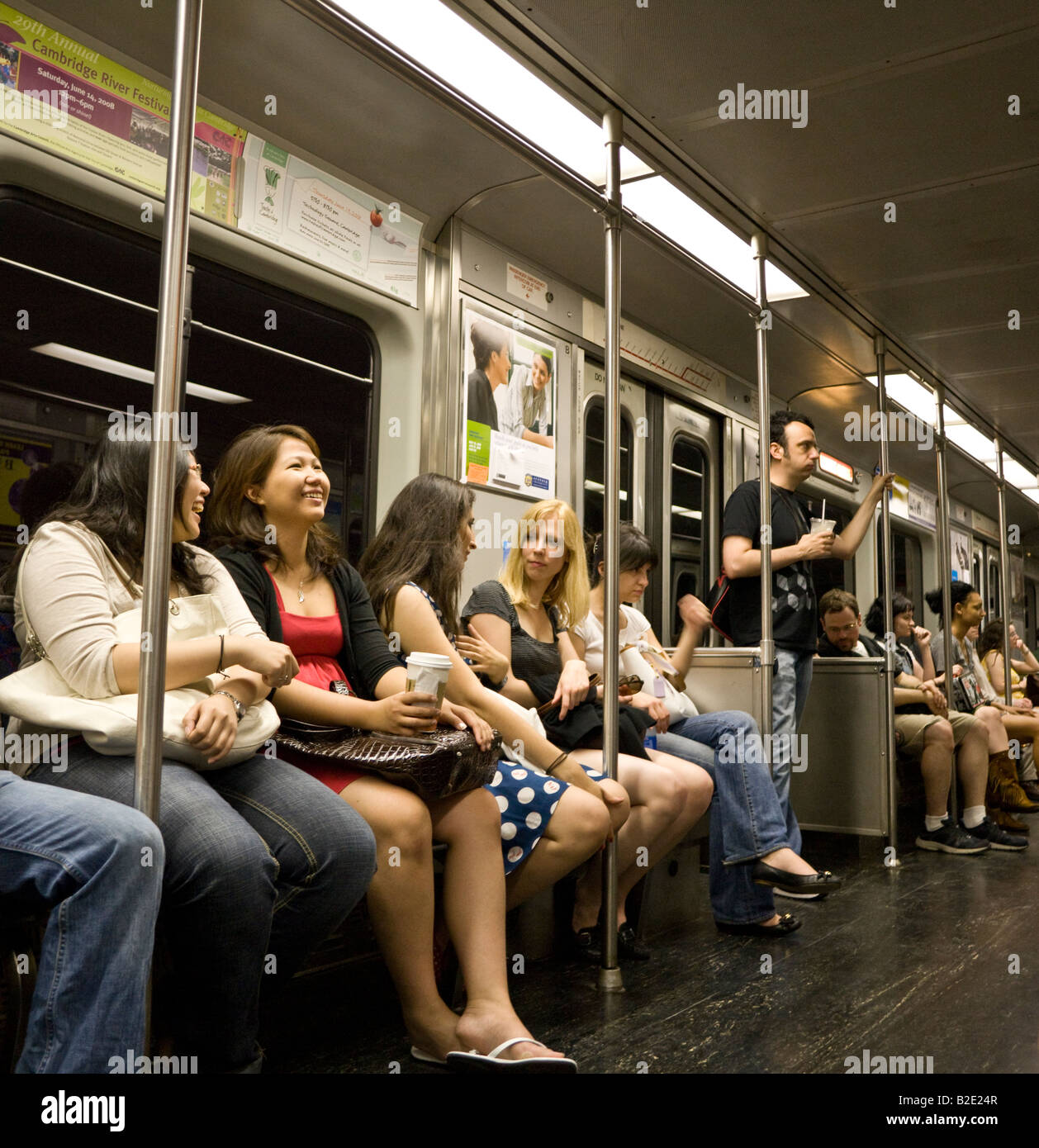 passengers on Cambridge Boston T metro train - Stock Image