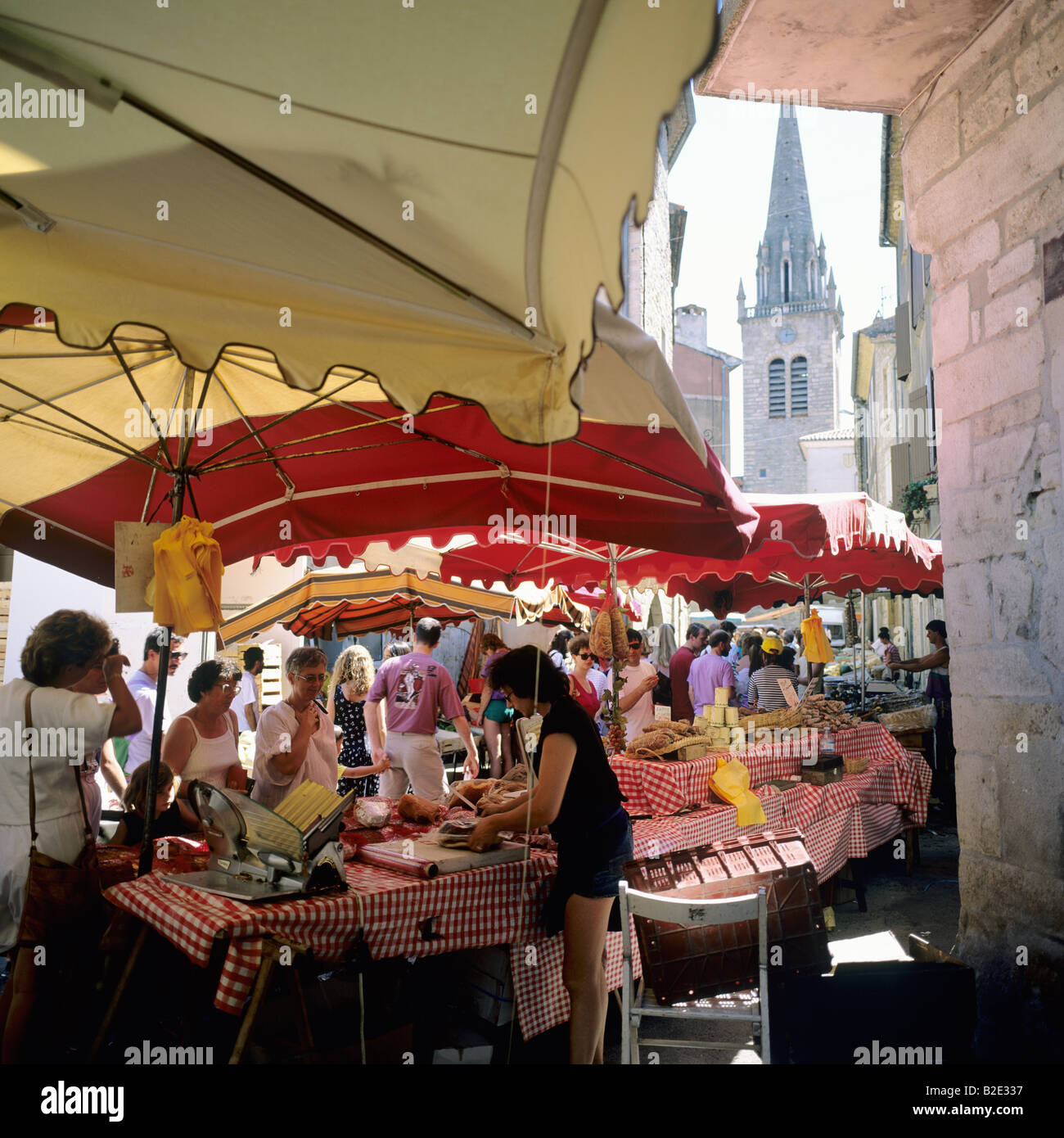 6a86d100d361c9 Butcher stall at weekly street market Les Vans Ardèche France - Stock Image