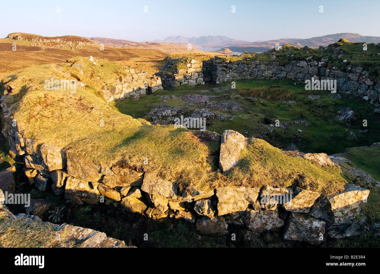 Double walled Dun Beag Broch 2000 year old circular settlement at Bracadale, Isle of Skye, Scotland. Cuillin mountains Stock Photo