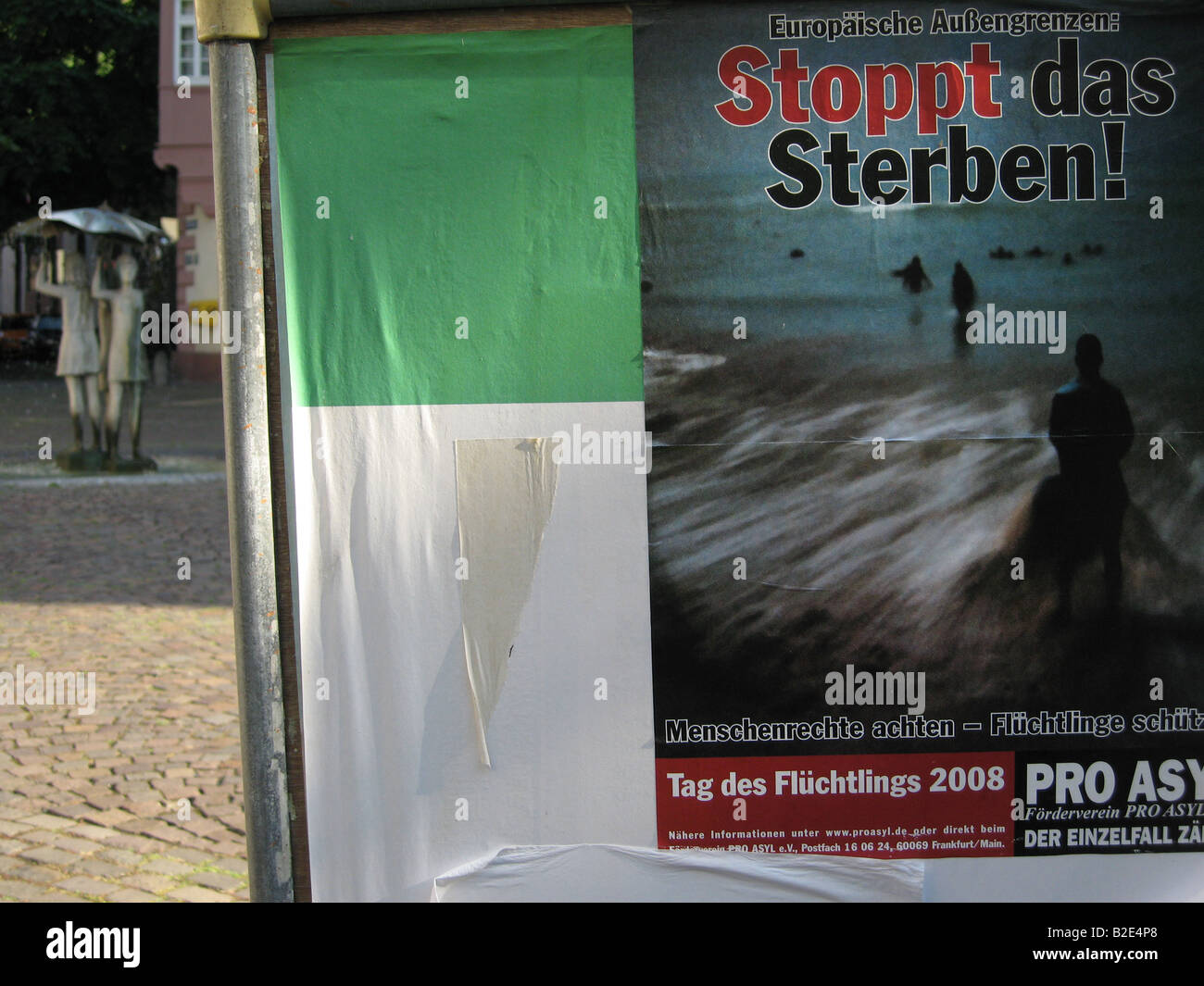 Advertising poster for an event organized by Amnesty International and Pro Asyl on a square in a german city - Stock Image