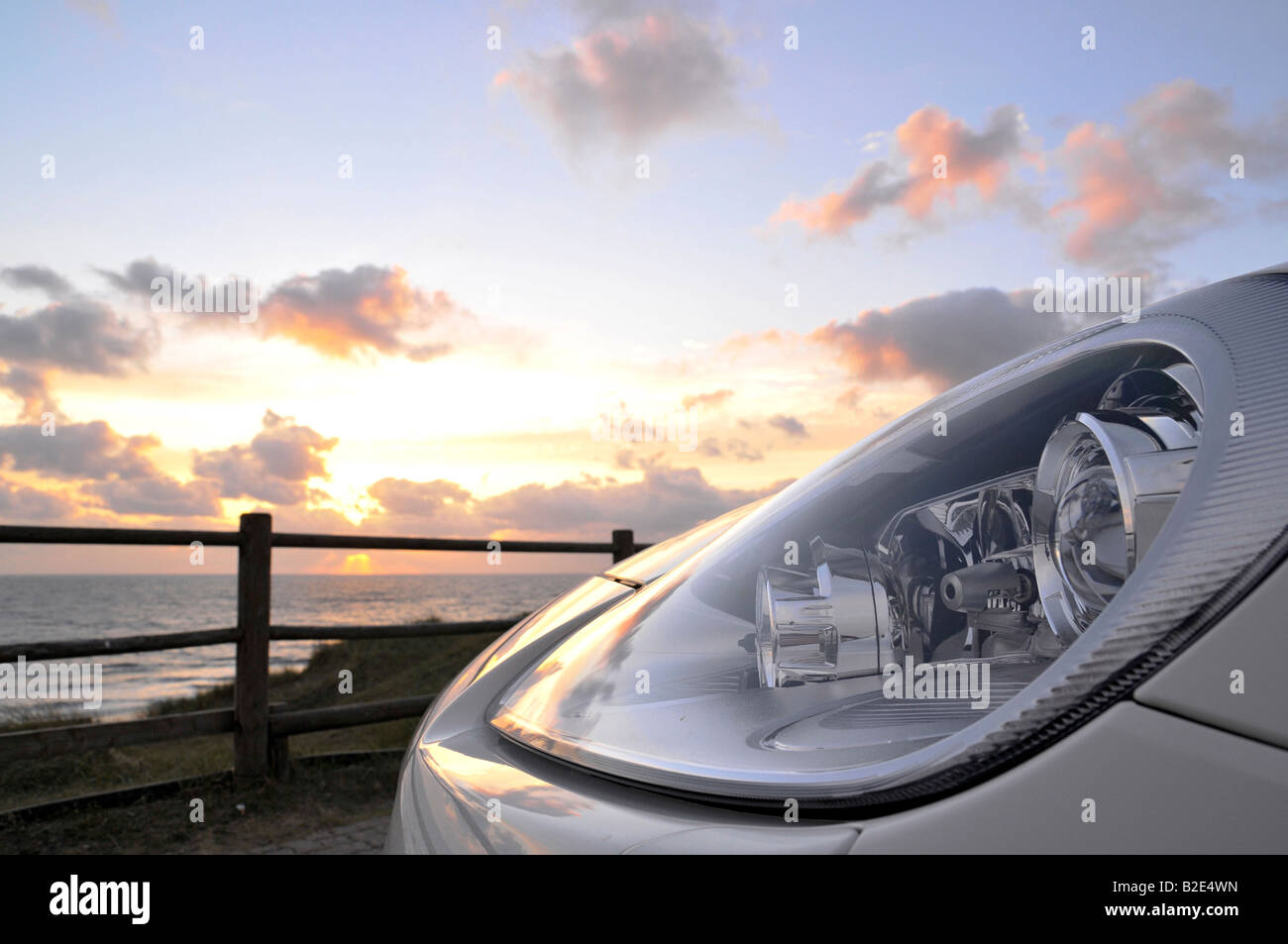 Headlamps of the PORSCHE CAYENNE GTS, detail, whit, sunset sky - Stock Image