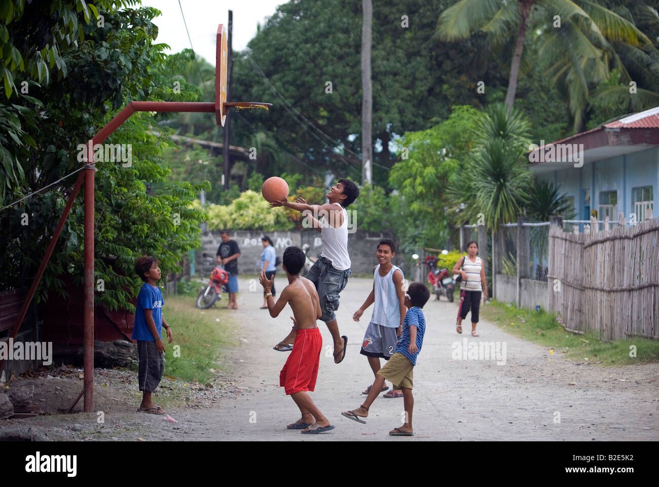 Filipino Children Play Basketball On A Street In Mansalay