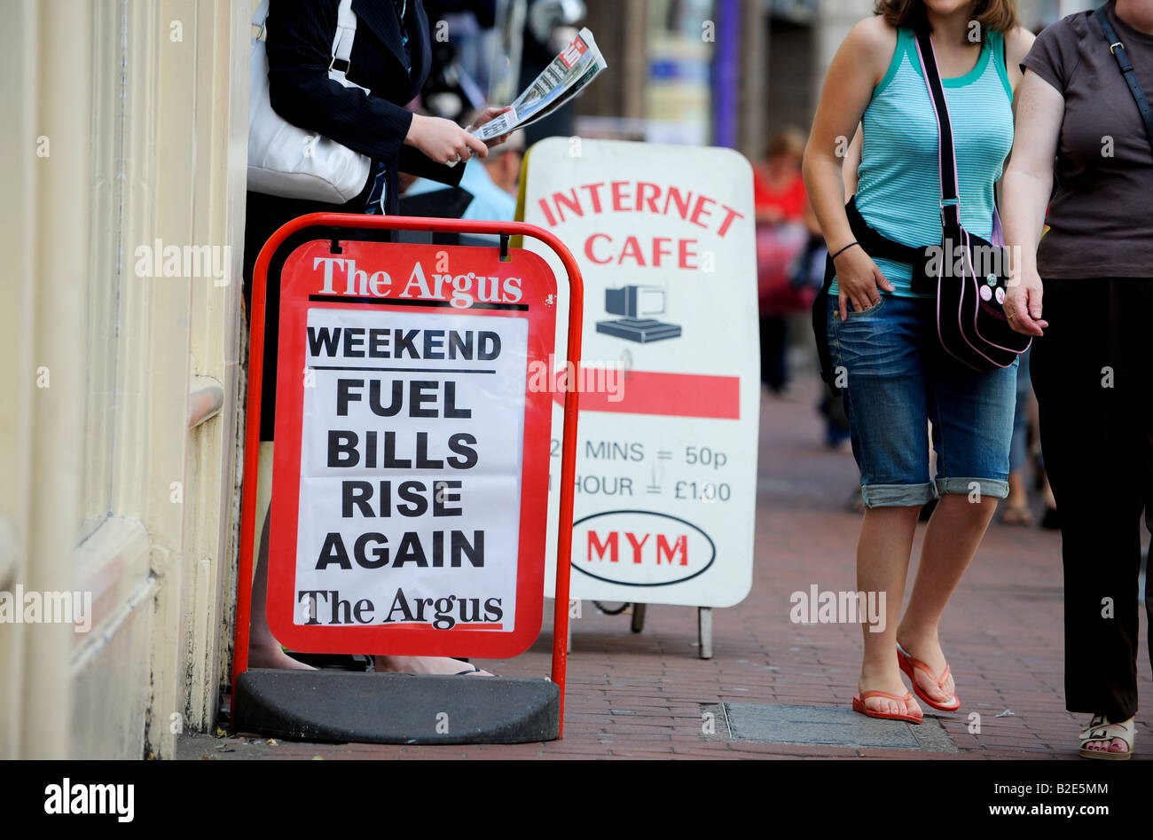 Credit crunch latest news: 'Fuel bills rise again' on a local paper pavement sign A-board. Picture by Jim - Stock Image