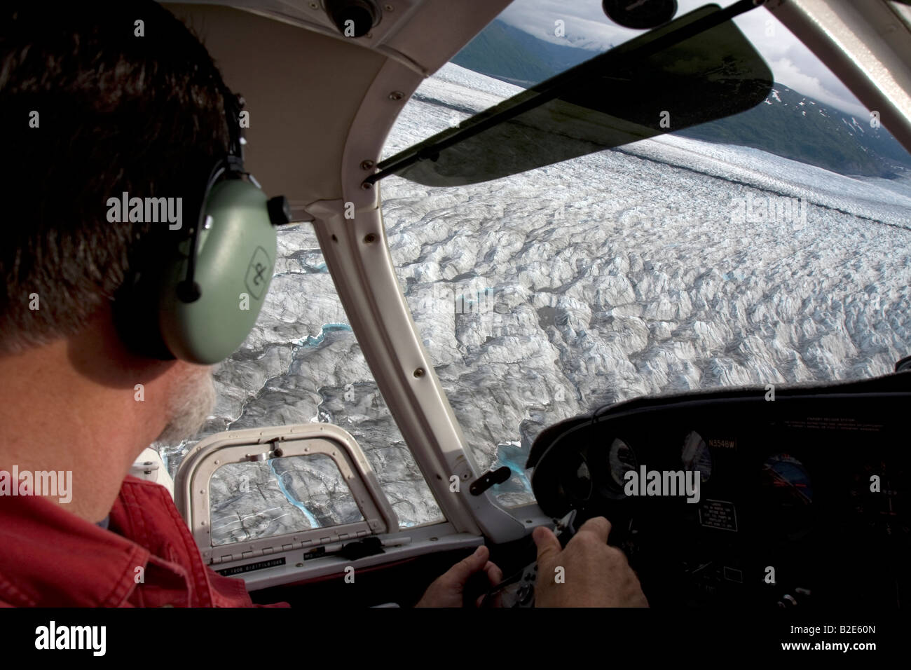 Flight seeing trip with small air plane plane over the Knik River valley towards Knik River Glacier, Palmer, Alaska, Stock Photo