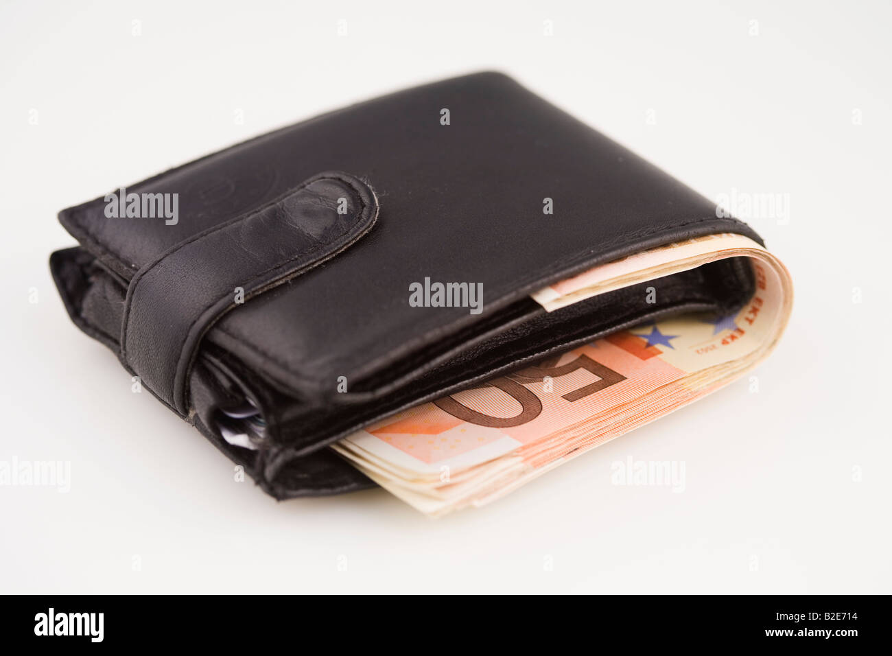 Wallet containing many fifty Euro notes - Stock Image