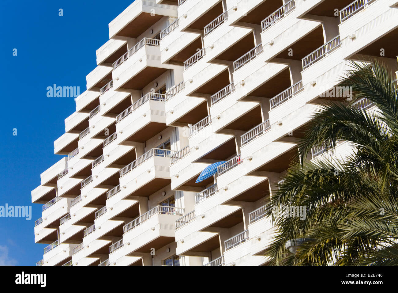 Balconies of apartment building forming repetitive pattern Torremolinos Costa del Sol Malaga Province Spain - Stock Image