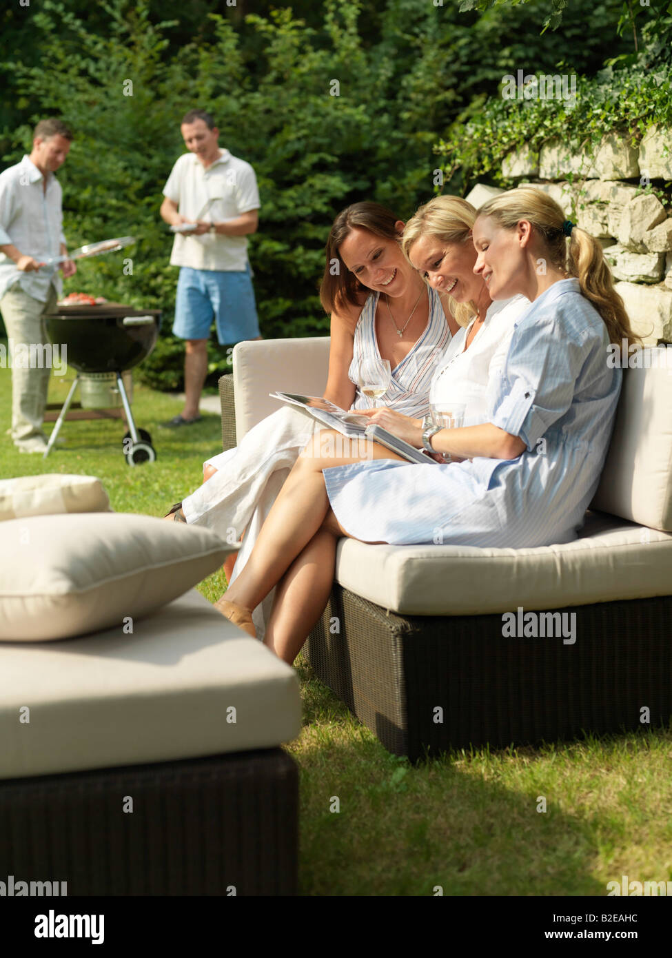 Group of women looking at photo album - Stock Image