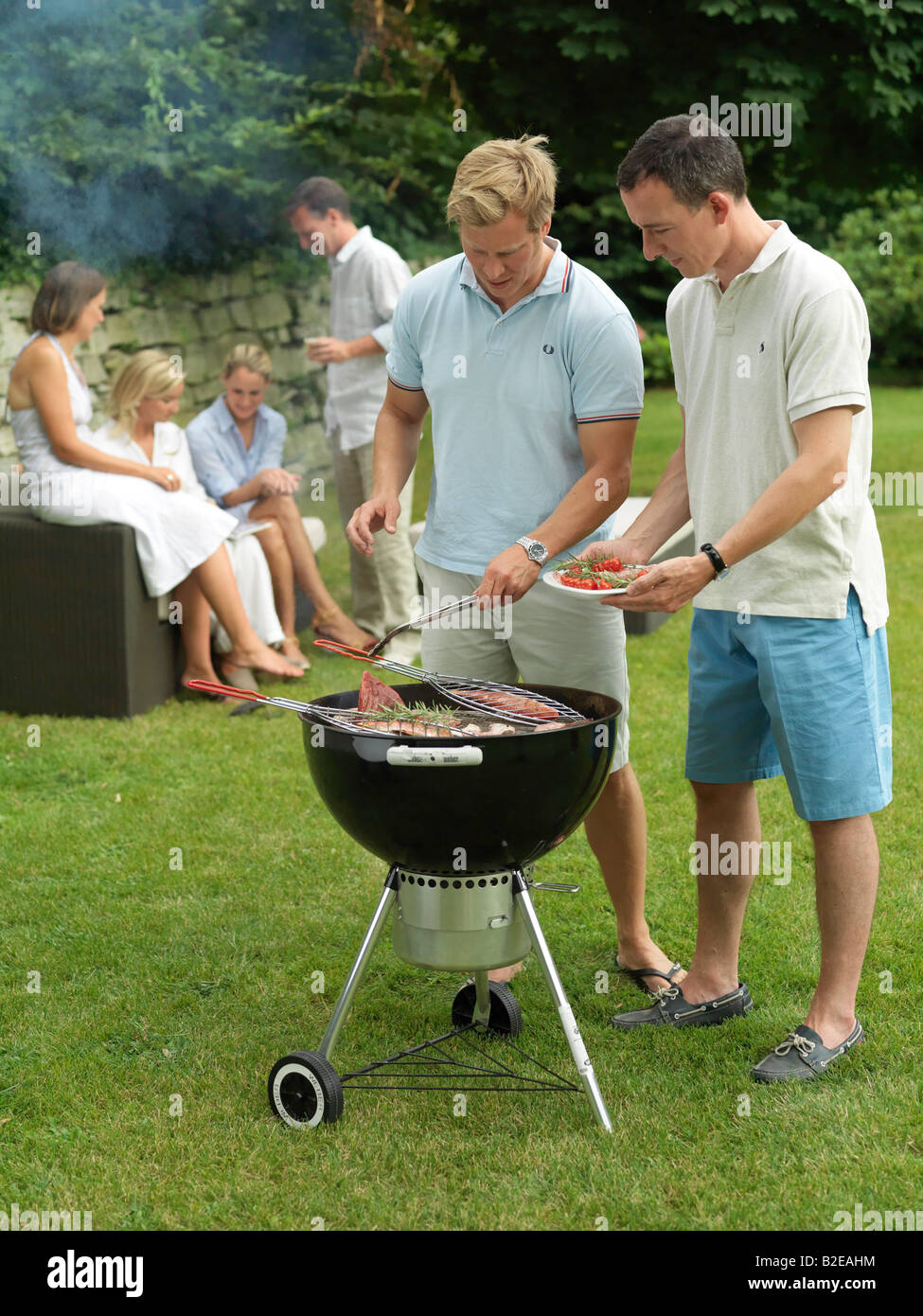 Group of people having barbecue - Stock Image