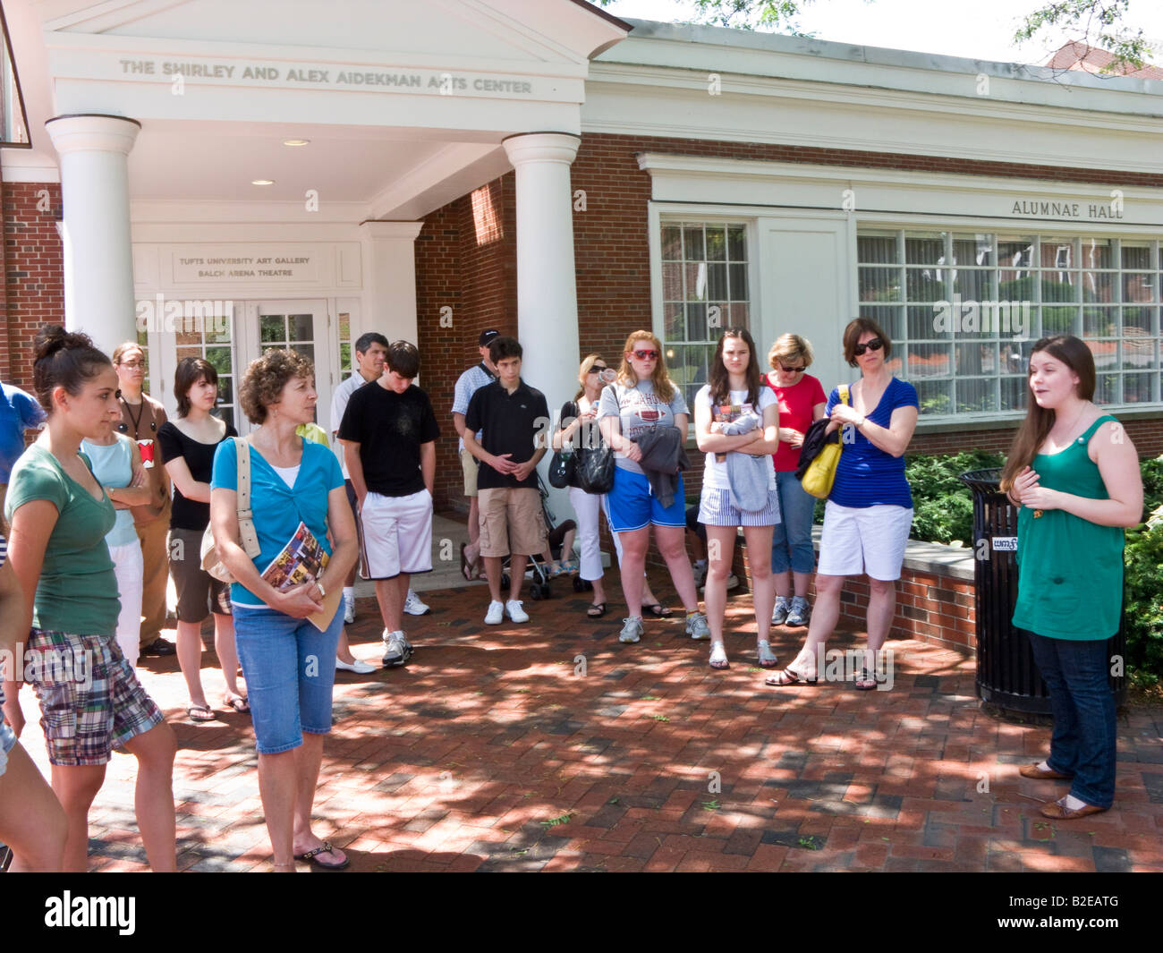 parents and prospective students on student-led admissions office tour of Tufts University crossing campus - Stock Image
