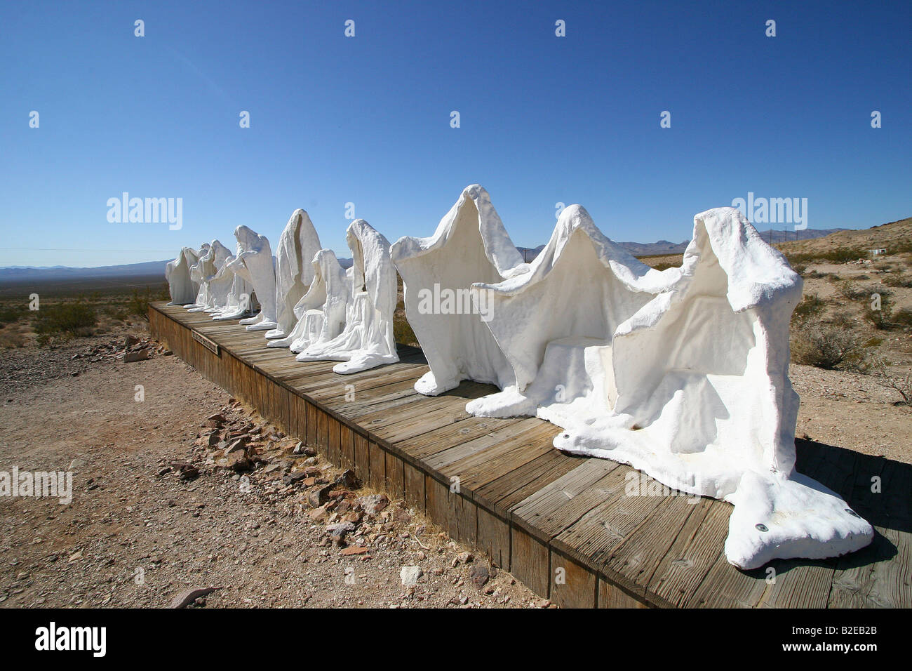 Sculptures of ghost on landscape, Goldwell Open Air Museum, Rhyolite, Nevada, USA - Stock Image