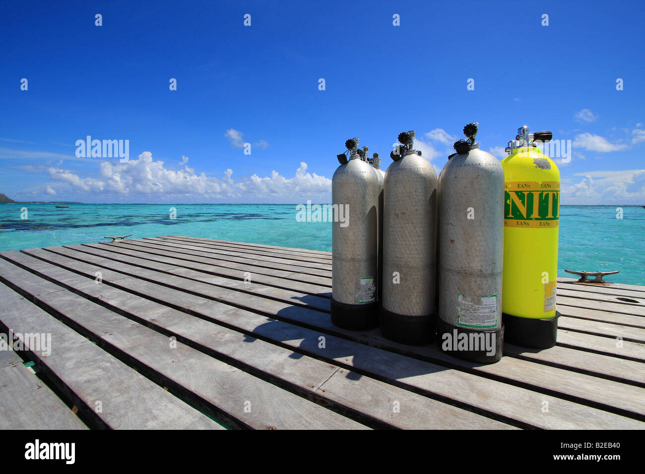 Diving cylinders on jetty, Tuamotu Archipelago, French Polynesia, Polynesia, Pacific Island - Stock Image