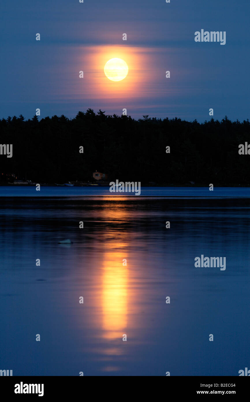 moon rise over a lake - Stock Image