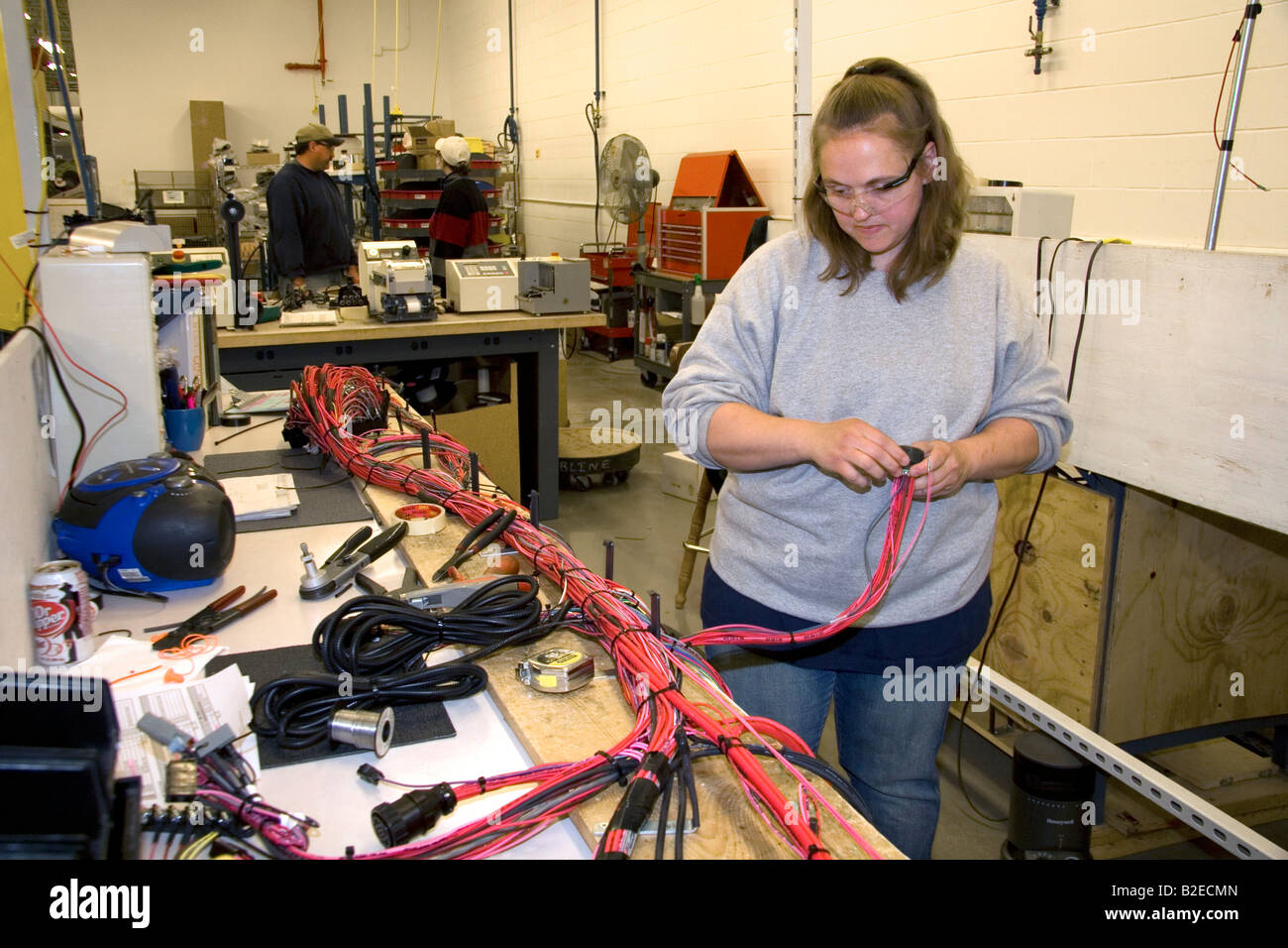 Wiring Harness Stock Photos Images Alamy Wire Manufacturer Female Worker With Assembly At Spartan Motors Truck Chassis Manufacturing In Charlotte Michigan