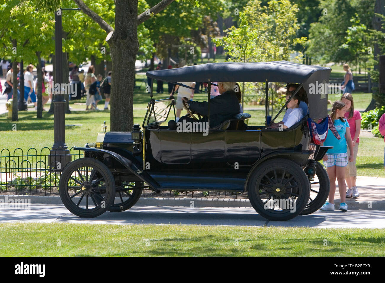 Visitors ride in a ford model t in greenfield village at the henry ford in dearborn michigan