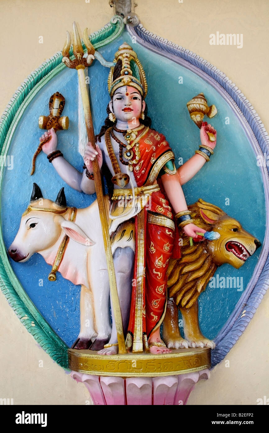 Ardhanari an androgynous deity composed of Shiva and his consort Shakti statue at a temple in India - Stock Image