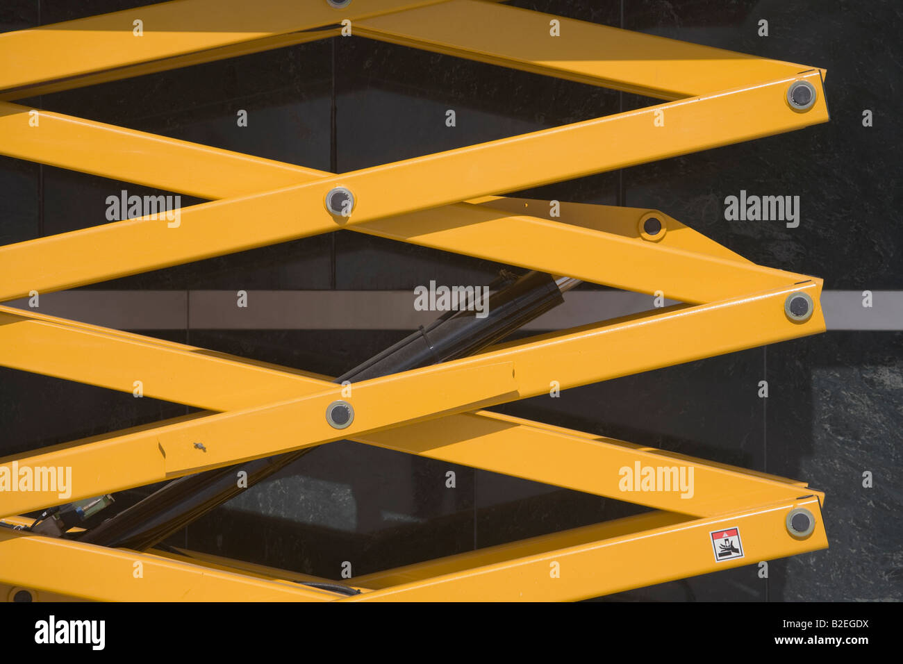 Detail of expandable column of scissor lift platform - Stock Image