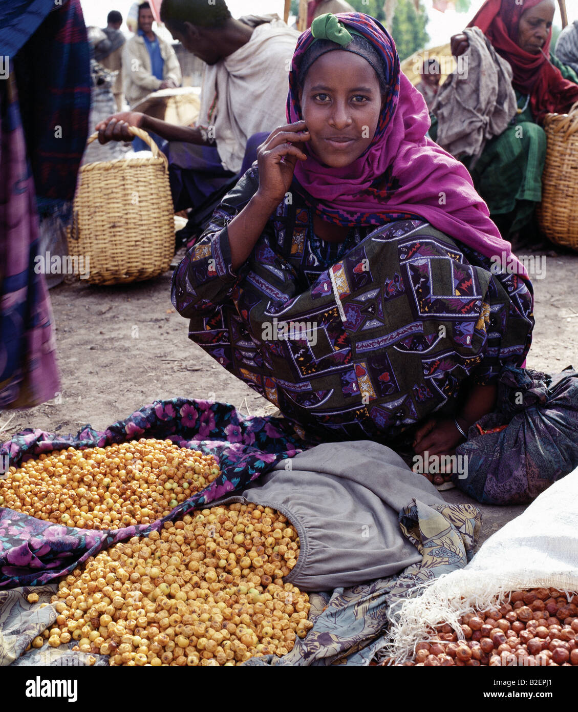 A woman sells dried berries at Bati market. Bati is the largest open-air market in Ethiopia. - Stock Image