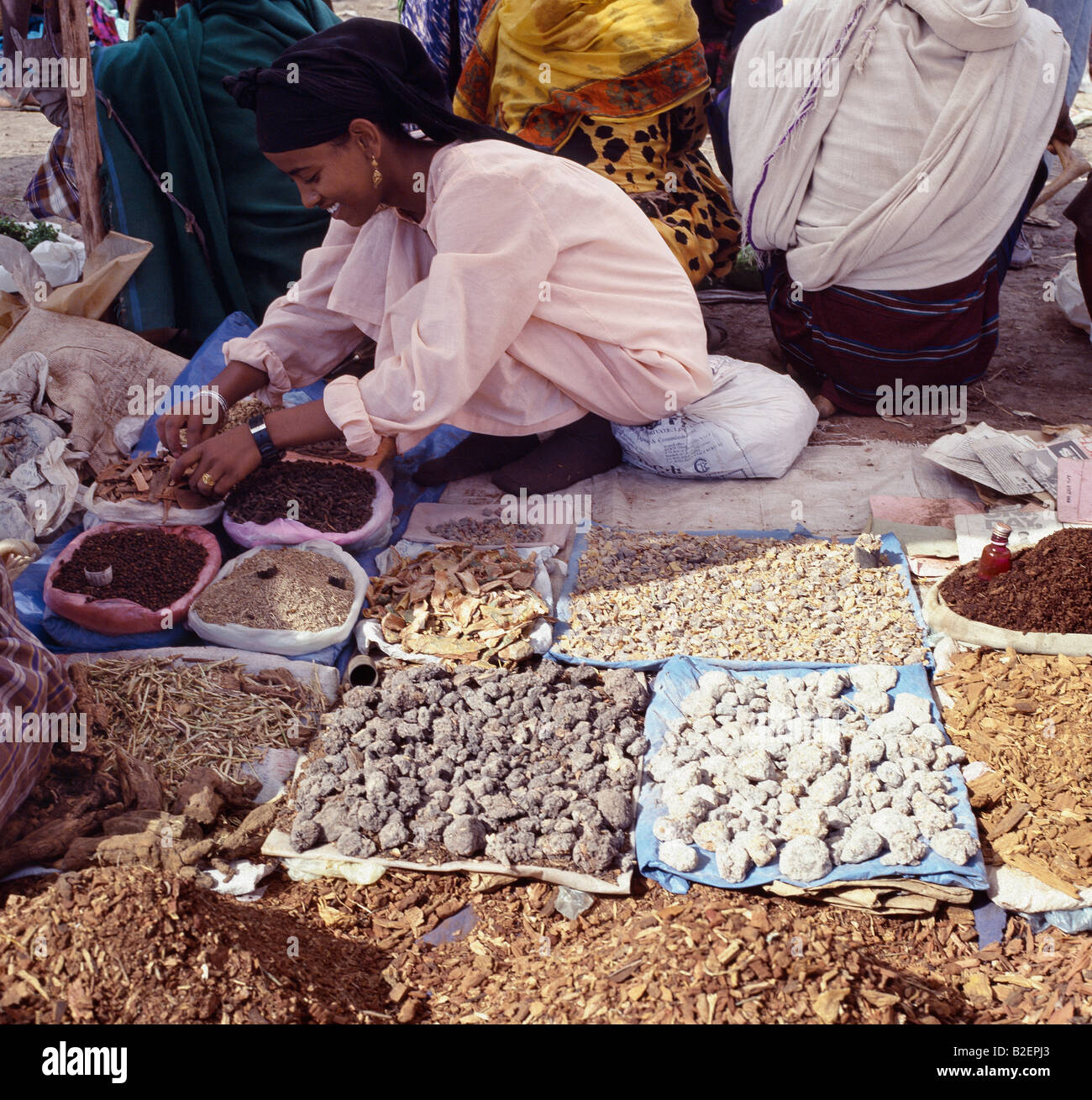 A woman sells various fragrant woods and frankincense at Bati market. Bati is the largest open-air market in Ethiopia. - Stock Image