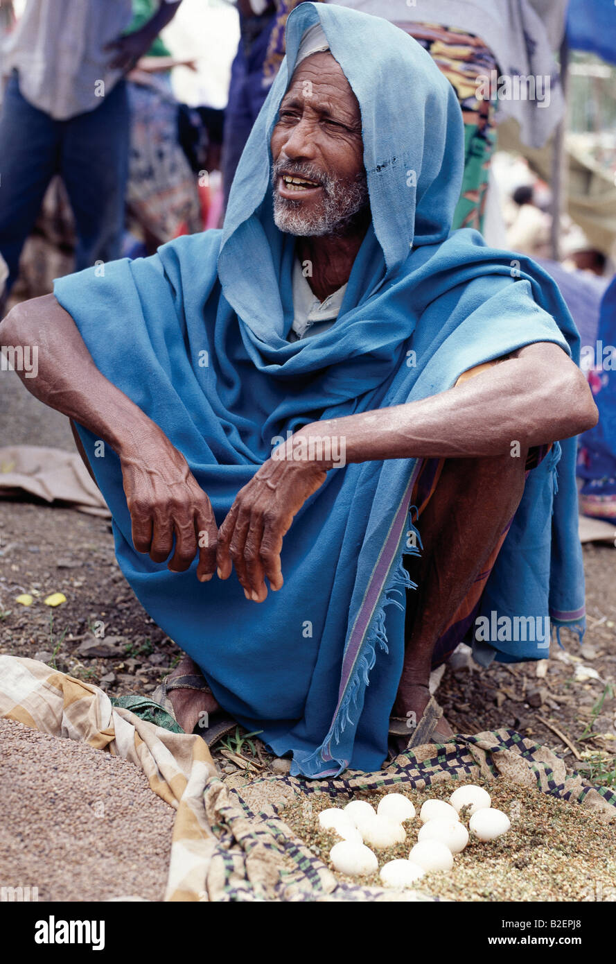 An old man sells eggs at Bati market. Bati is the largest open-air market in Ethiopia. - Stock Image