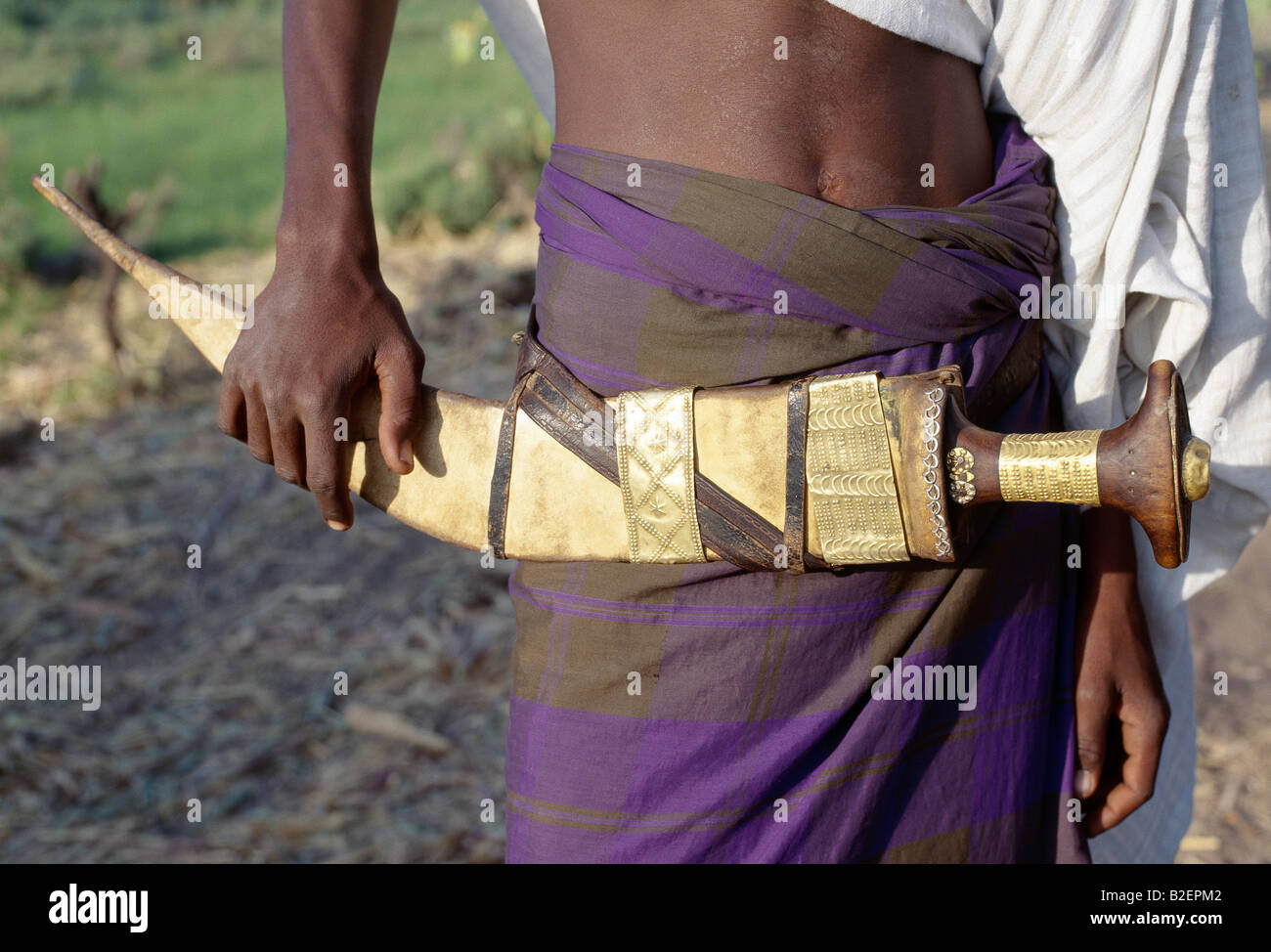 Warriors of the nomadic Afar tribe carry large curved daggers, known as jile, strapped to their waists. - Stock Image