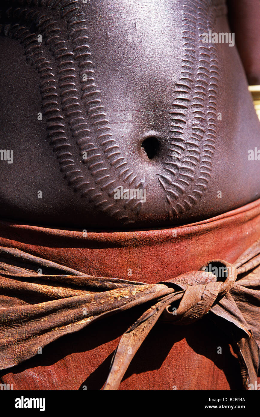 A Nyangatom woman with ornamental scarring on her stomach. The scarrs are made with a razor and then infected with Stock Photo