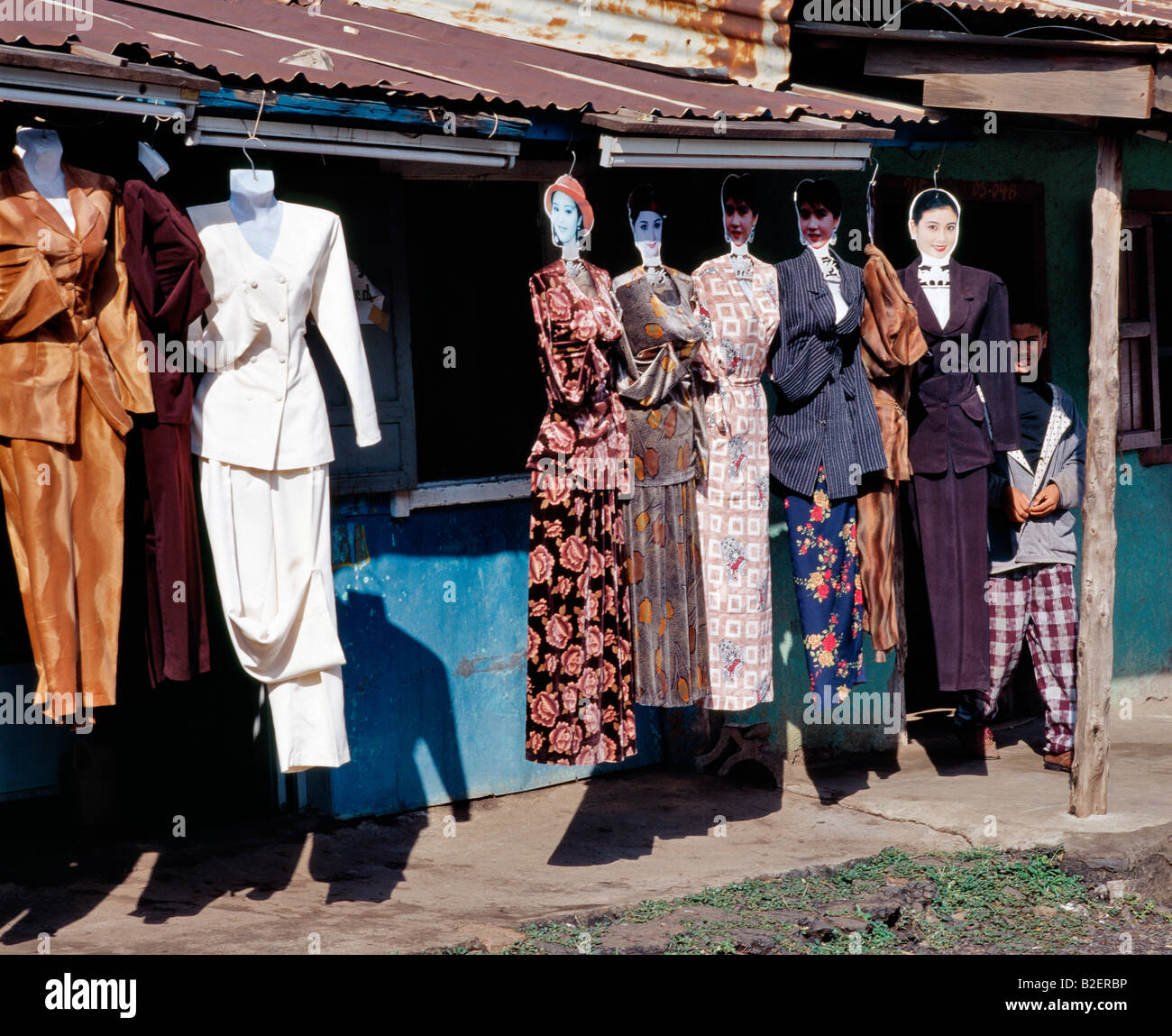 Unconventional tailors' dummies display ladies' dresses on the side of the road at Dese. - Stock Image