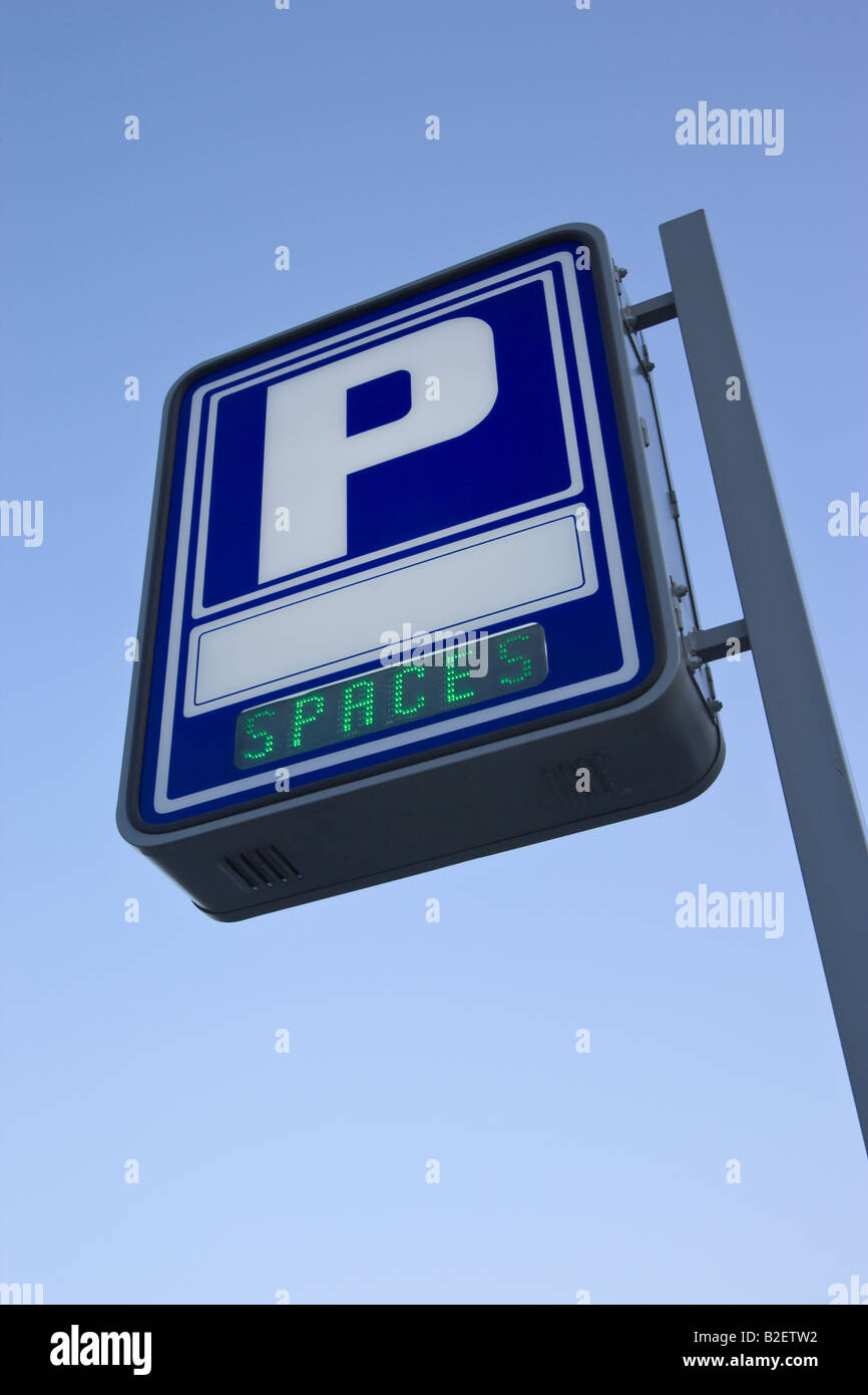 Parking garage sign advertising spaces available - Stock Image