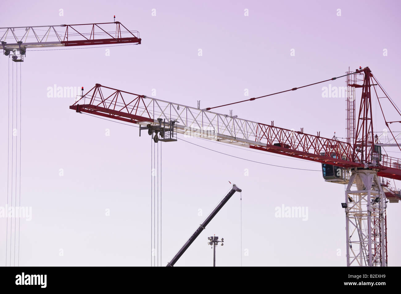 Cranes on construction site - Stock Image